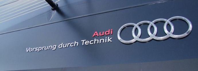 "Audi's tagline, says Vorsprung durch technik, written on a black storefront"" width=""690"" height=""249"" srcset=""https://blog.hubspot.com/hs-fs/hubfs/audi-slogan.jpg?t=1536141269374&width=345&height=125&name=audi-slogan.jpg 345w, https://blog.hubspot.com/hs-fs/hubfs/audi-slogan.jpg?t=1536141269374&width=690&height=249&name=audi-slogan.jpg 690w, https://blog.hubspot.com/hs-fs/hubfs/audi-slogan.jpg?t=1536141269374&width=1035&height=374&name=audi-slogan.jpg 1035w, https://blog.hubspot.com/hs-fs/hubfs/audi-slogan.jpg?t=1536141269374&width=1380&height=498&name=audi-slogan.jpg 1380w, https://blog.hubspot.com/hs-fs/hubfs/audi-slogan.jpg?t=1536141269374&width=1725&height=623&name=audi-slogan.jpg 1725w, https://blog.hubspot.com/hs-fs/hubfs/audi-slogan.jpg?t=1536141269374&width=2070&height=747&name=audi-slogan.jpg 2070w"" sizes=""(max-width: 690px) 100vw, 690px"