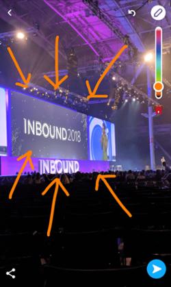 Snapchat da INBOUND 2018 con frecce arancioni tratte dall'icona di disegno