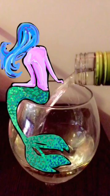 """mermaid-wine-snapchat.png"""" title=""""mermaid-wine-snapchat.png"""" width=""""357"""" height=""""635"""" srcset=""""https://blog.hubspot.com/hs-fs/hubfs/mermaid-wine-snapchat.png?t=1539571477767&width=179&height=318&name=mermaid-wine-snapchat.png 179w, https://blog.hubspot.com/hs-fs/hubfs/mermaid-wine-snapchat.png?t=1539571477767&width=357&height=635&name=mermaid-wine-snapchat.png 357w, https://blog.hubspot.com/hs-fs/hubfs/mermaid-wine-snapchat.png?t=1539571477767&width=536&height=953&name=mermaid-wine-snapchat.png 536w, https://blog.hubspot.com/hs-fs/hubfs/mermaid-wine-snapchat.png?t=1539571477767&width=714&height=1270&name=mermaid-wine-snapchat.png 714w, https://blog.hubspot.com/hs-fs/hubfs/mermaid-wine-snapchat.png?t=1539571477767&width=893&height=1588&name=mermaid-wine-snapchat.png 893w, https://blog.hubspot.com/hs-fs/hubfs/mermaid-wine-snapchat.png?t=1539571477767&width=1071&height=1905&name=mermaid-wine-snapchat.png 1071w"""" sizes=""""(max-width: 357px) 100vw, 357px"""