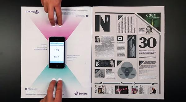 Annuncio di stampa interattivo di Sonera con gioco da tavolo per smartphone.